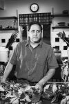 Chef Damon Baehrel in his auxillary kitchen. Baehrel uses plants, herbs, barks, and mosses sourced from his property to create his signature dishes.